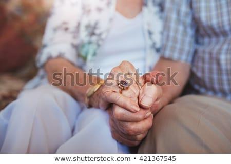 Kezek érett pár feleség gondozó tart Stock fotó © pressmaster