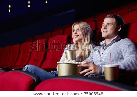 Young couple sitting at red movie theatre Stock photo © ra2studio