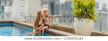 Anne oğul havuz gökdelenler büyük şehir Stok fotoğraf © galitskaya