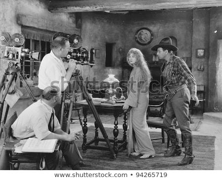 cowboy cameraman vintage movie camera retro stock photo © patrimonio
