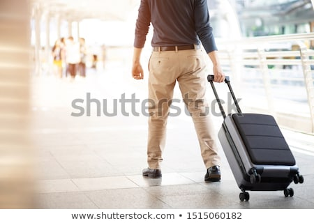 man pulling a trolley case on the street Stock photo © nito