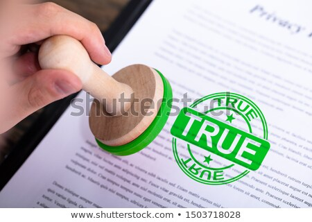 Businessman Putting True Stamp On Document Stock photo © AndreyPopov