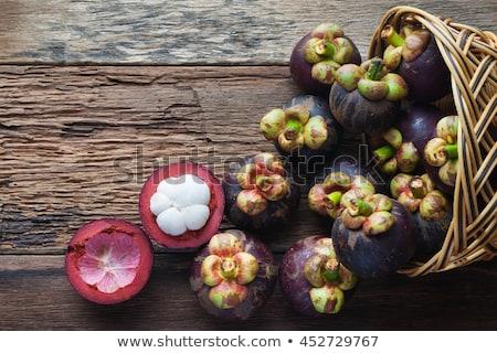 Mangosztán gyümölcs fa asztal öreg fa asztal trópusi Stock fotó © galitskaya