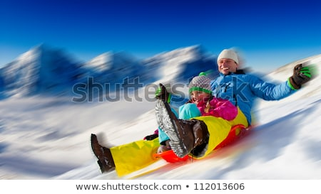 Father Rides Kid on Sled, Winter Cold Weather Stock photo © robuart