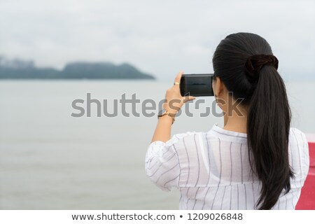 Selfie picture with phone woman tourist holding cellphone taking self-portrait photo on summer holid Stock photo © Maridav