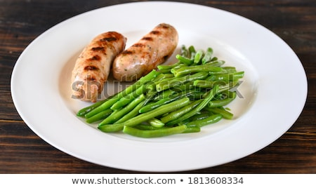 Fried green beans with grilled sausages Stock photo © Alex9500