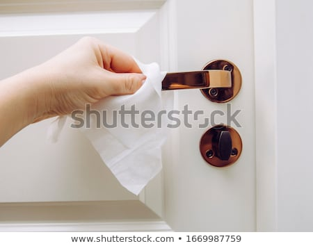 Donna pulizia porta gestire medicina Foto d'archivio © Novic