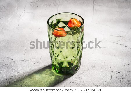Colored stones in a glass of water Stock photo © cienpies