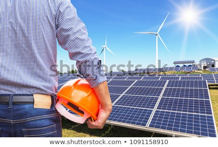 Painéis solares alternativa energia renovável vermelho pôr do sol Foto stock © artjazz