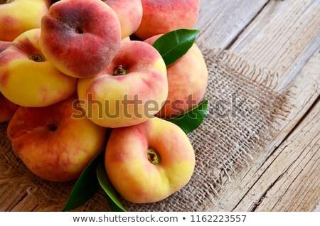fresco · pêssego · raso · fruto - foto stock © bobkeenan