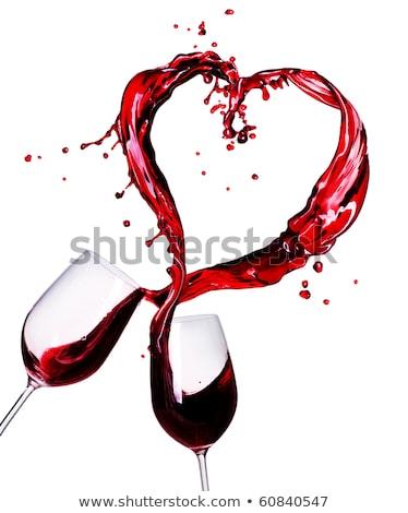 paixão · amor · vermelho · líquido · forma · de · coração · isolado - foto stock © arsgera