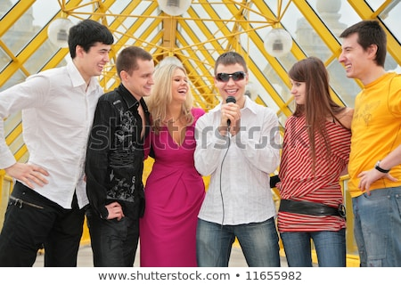 group of young people with microphone on footbridge Stock photo © Paha_L