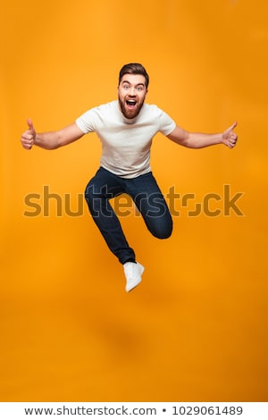 Excited man student jumping Stock photo © lovleah