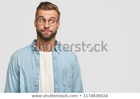 Stock photo: Portrait of handsome thoughtful businessman