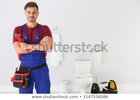 Stock photo: portrait of a young plumber