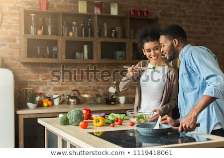 Couple preparing dinner in the kitchen Stock photo © photography33