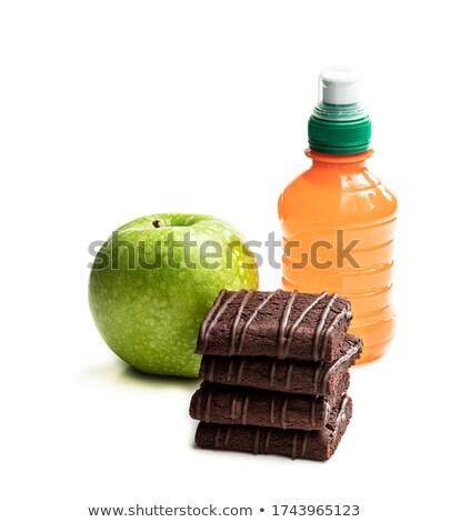 Kid Eating Brownies And Drinking Orange Juice Stock photo © stuartmiles