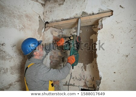 Mason using chainsaw to cut brick Stock photo © photography33
