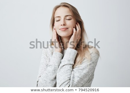 fair-haired woman with earphones Stock photo © photography33