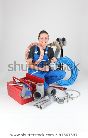 Female plumber crouching by equipment Stock photo © photography33