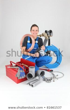 female plumber crouching by equipment stock photo © photography33