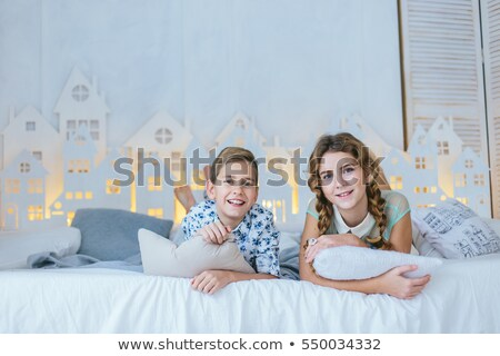 Young boy pulling his sister's braid Stock photo © photography33