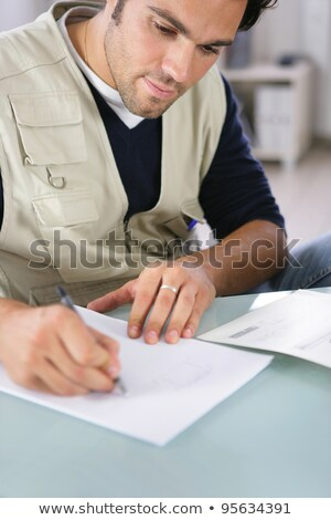 Builder writing on a piece of paper Stock photo © photography33