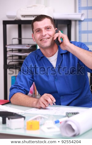 blue collar worker in his office and on the phone Stock photo © photography33