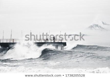 man on the pier stock photo © ruzanna