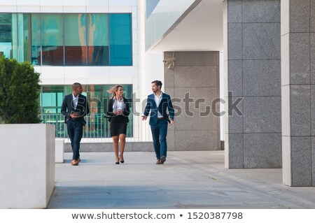Uśmiechnięty człowiek koledzy na zewnątrz biurowiec działalności Zdjęcia stock © photography33