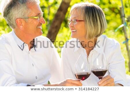 Retiree enjoying a glass of wine Stock photo © photography33
