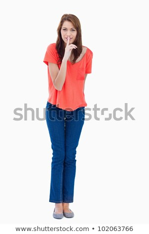 Young woman showing a quiet gesture and standing upright Stock photo © wavebreak_media