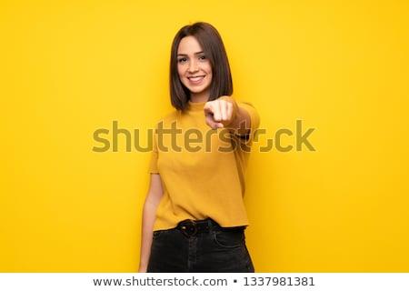 Stok fotoğraf: Gülen · genç · kadın · bakıyor · işaret · doğru · mavi