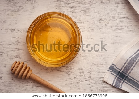 Honey in spoon with acacia and glass bowl Stock photo © manaemedia