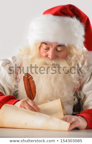 Real Santa Claus writing list of gifts or responding to children Stock photo © HASLOO