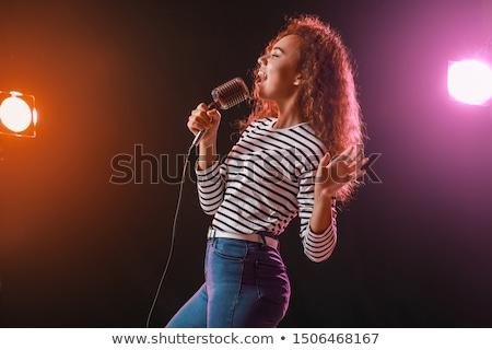Güzel kadın şarkıcı mikrofon yalıtılmış beyaz Stok fotoğraf © AndreyPopov