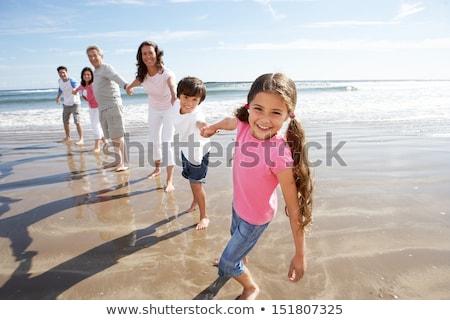 Többgenerációs család szórakozás tengerparti nyaralás nő lány férfi Stock fotó © monkey_business