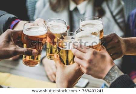 Woman enjoying a drink in a pub or restaurant Stock photo © d13