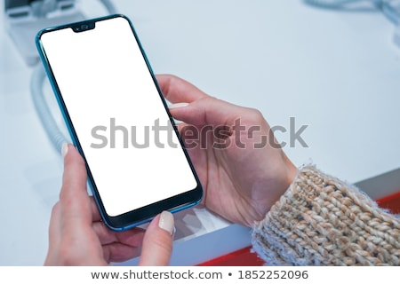 Olhando novo mulheres jogar telefone móvel menina Foto stock © aza