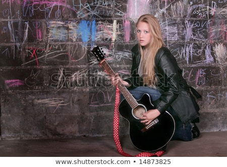 rocker playing guitar kneeling Stock photo © PetrMalyshev