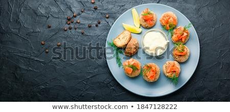 Balık lezzetli sarımsak sos kahverengi Stok fotoğraf © zhekos