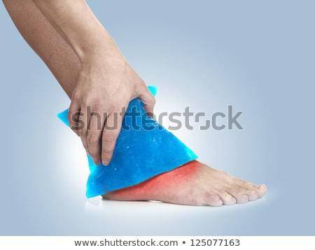 mulher · gelo · empacotar · tornozelo - foto stock © Flareimage