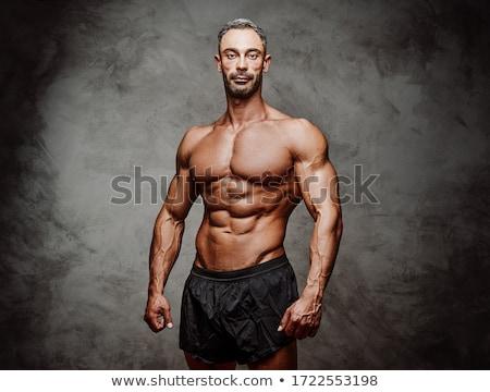 muscular man wearing gray athletic shorts stock photo © stryjek