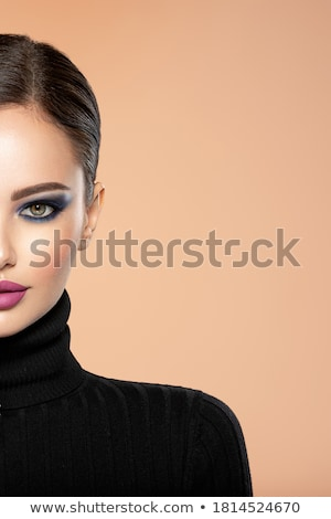 pretty woman with a makeup brush isolated on white stock photo © nobilior