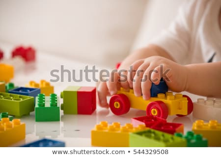 boy plays with plastic constructor in kindergarten stock photo © paha_l