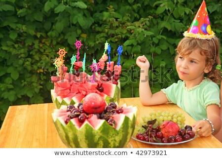 little girl eats fruit in garden, happy birthday party seven yea Stock photo © Paha_L