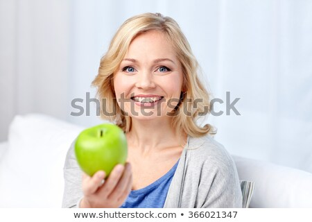 Woman On Sweet and Sour Apple Stock photo © piedmontphoto