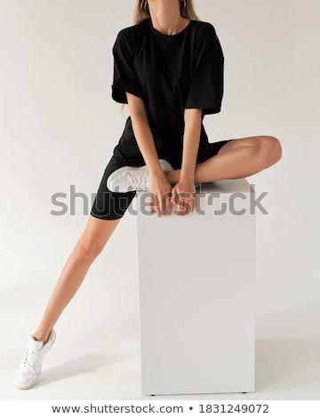 Sports girl in black Stock photo © bezikus