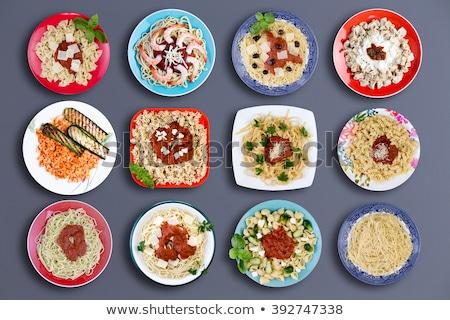Doze delicioso macarrão pratos topo para baixo Foto stock © ozgur