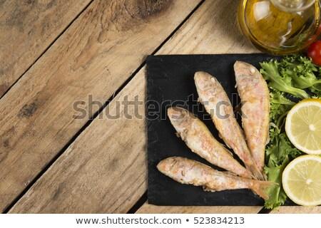 Rojo frescos crudo azul rústico mesa de madera Foto stock © marimorena